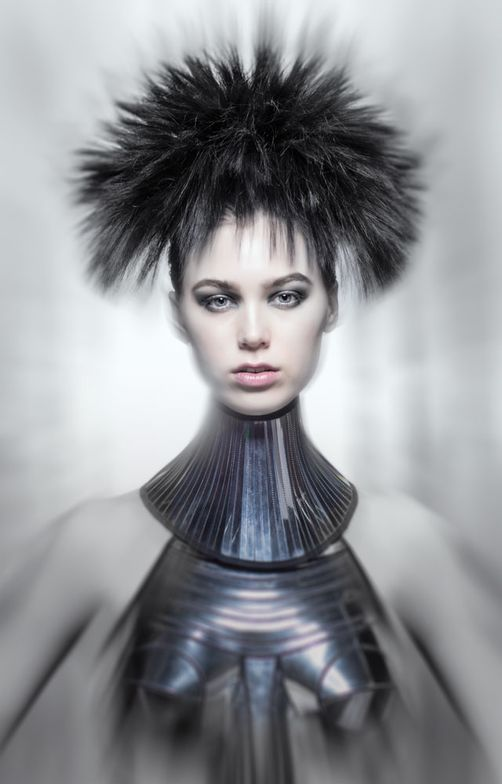 Hair was put into small ponytails all over the head and Hairdreams extensions were added and razored down to three inches. Each section was misted with hairspray and then crimped at the base, to give the tufts more volume.