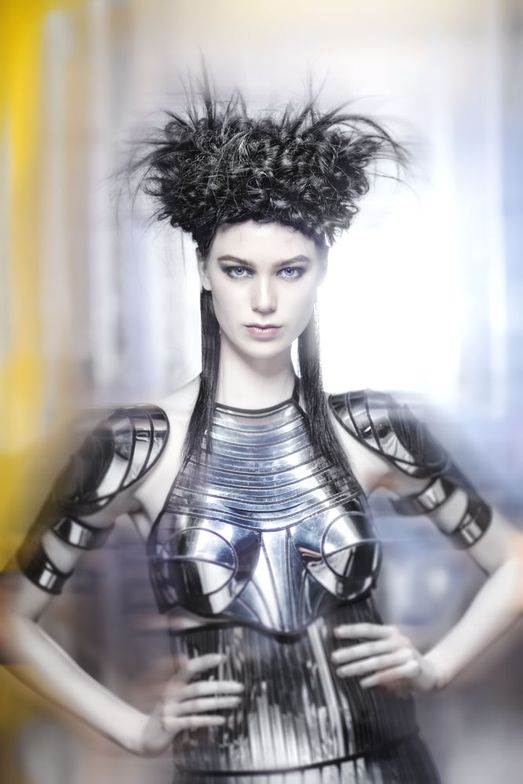 The hair was merged with extra black Hairdreams Quikkies and pulled through mesh using a crochet hook to create large, irregular loops. All the ends were left out on the top to create a soft waterfall.