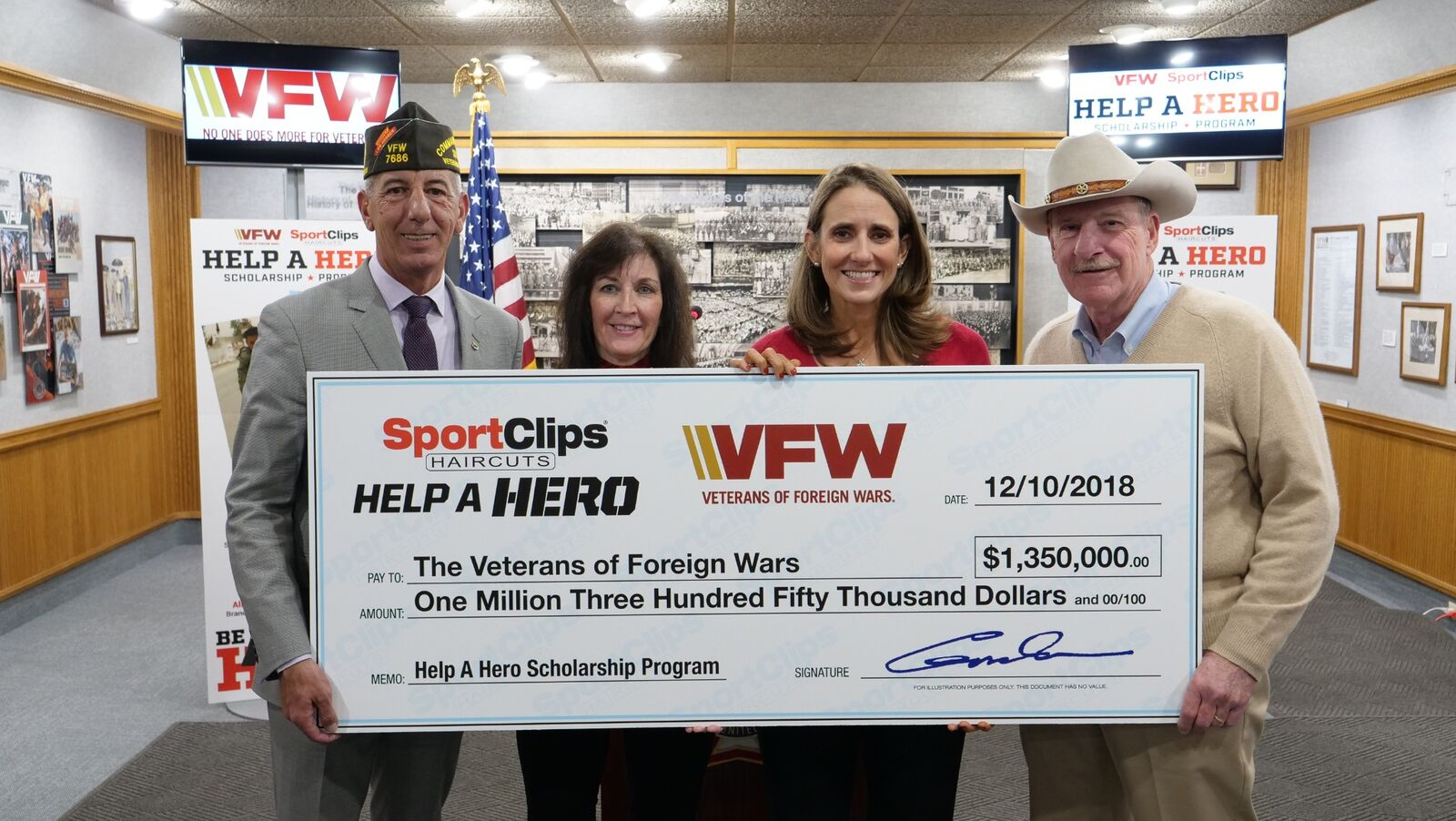 Sport Clips Haircuts just donated $1.35 million to the VFW for Help A Hero Scholarships for veterans. Pictured at the check presentation (l to r) B.J. Lawrence, VFW  Commander-in-Chief; Martha England, Sport Clips Haircuts vice president of marketing; Amanda Palm, Sport Clips Haircuts communications manager; and Gordon Logan, USAF veteran and Sport Clips Haircuts founder and CEO. Sport Clips Haircuts