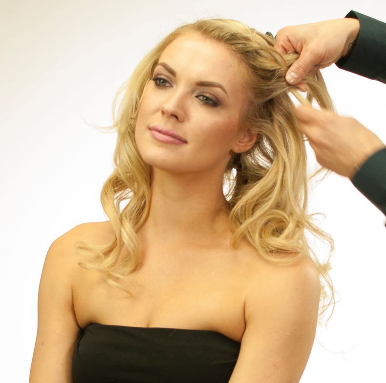 <p>Braid the hair with 2 strands from the side part in the front to the ponytail in the nape area.</p> <p>Secure this with pins, loosen up the braid and finish with Royal Treatment Ultimate Control Hairspray.</p>