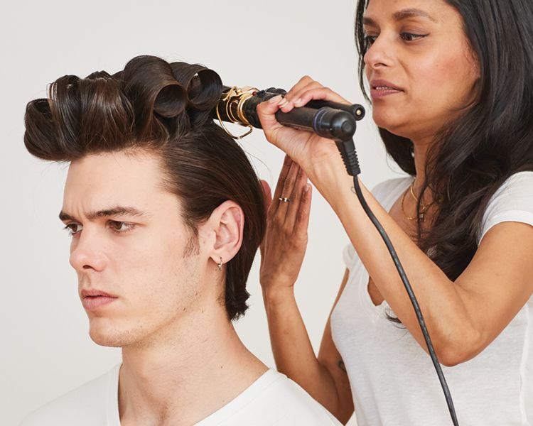 """<strong>Step 3: </strong>Curl top sub-sections with a 2"""" iron and <strong>Flex Hairspray</strong>. Set each curl."""