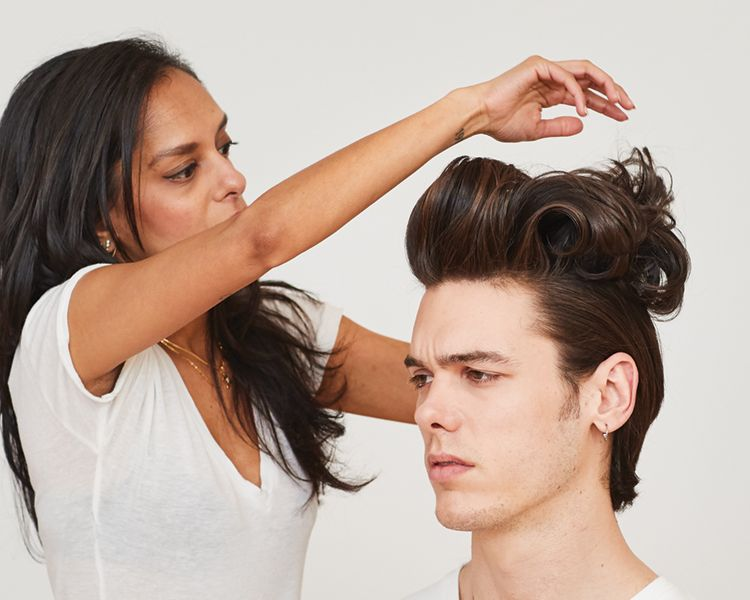 <strong>Step 4: </strong>After set cools, unpin and use your fingers to comb through hair to create the pompadour.
