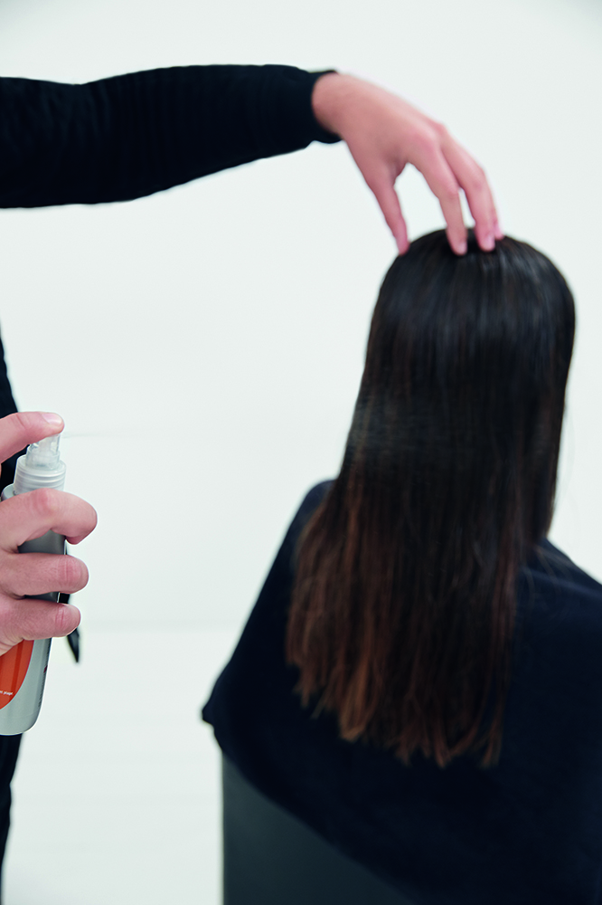 STYLE STEP 1: Apply Wella Professionals Volume Sugar Lift to the hair.
