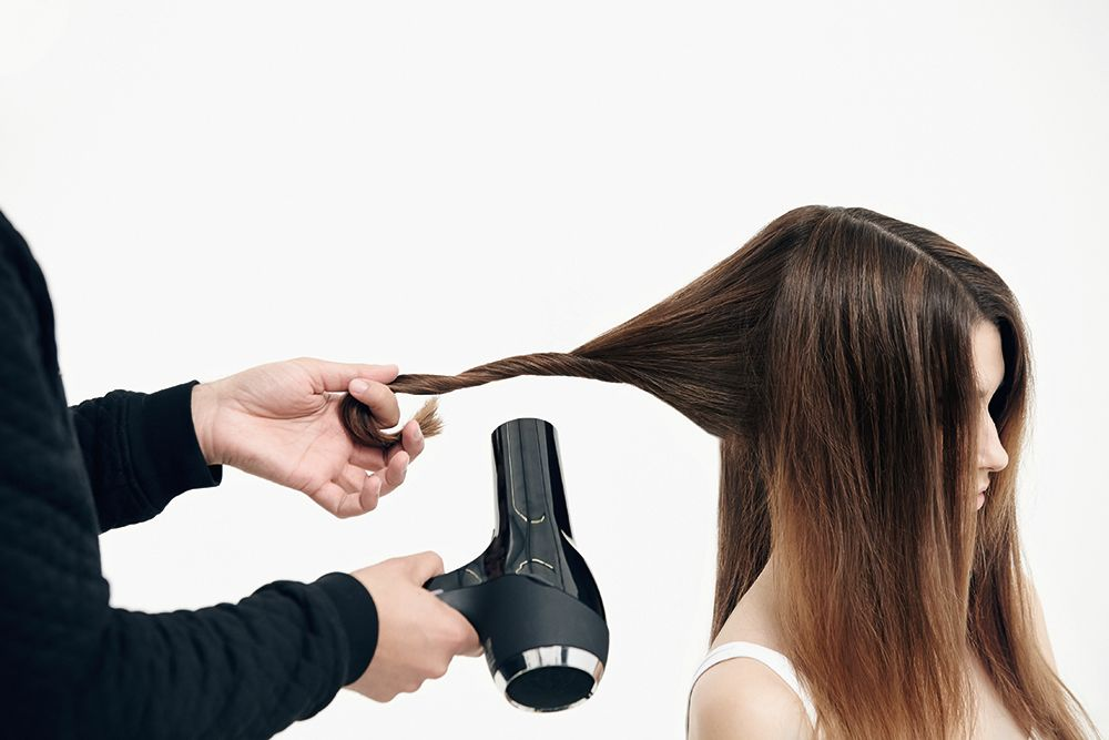 STYLE STEP 2: Take a wide section starting in the back, twist it and blow-dry.