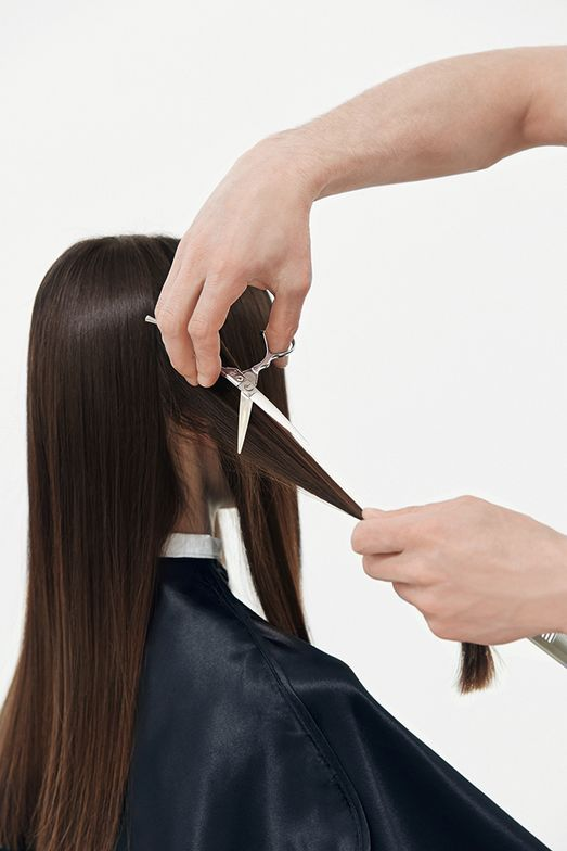 CUT STEP 2: Take a middle parting. Use the same slicing technique on either side.