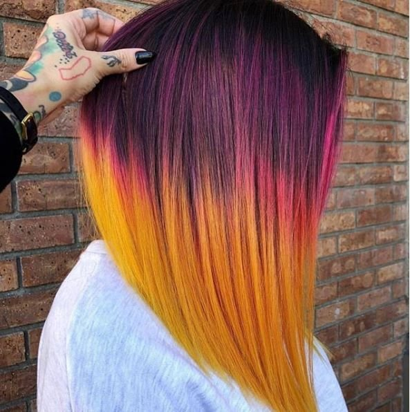 <p>This stunning color melt emphasizes the edgy cut created. The final result is a tropical sunset that leaves us in bliss. </p>