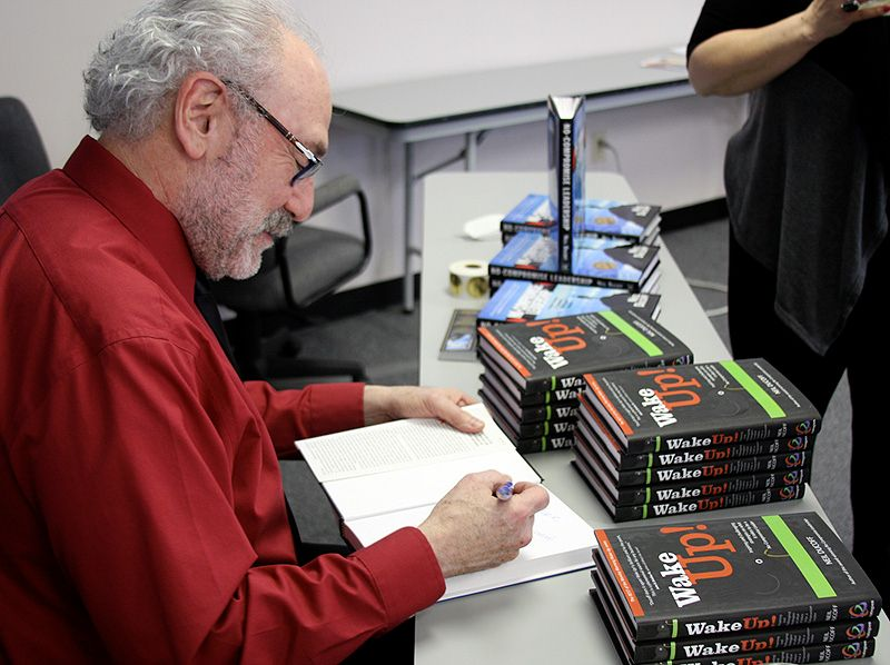 Neil Ducoff signs his new book, Wake Up! for SALON TODAY 200 salon owner attendees.