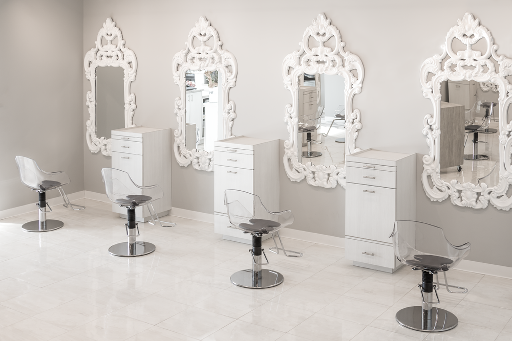 Barouque-style mirrors and acrylic chairs add a clean feminine touch to the styling floor.