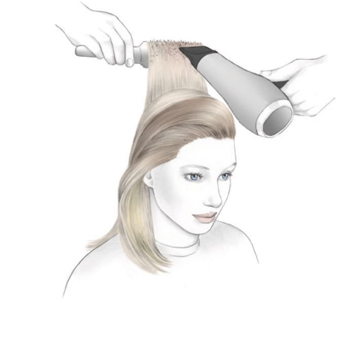 <strong>STEP 6:</strong> Use a large round brush to create shine and a smooth surface.