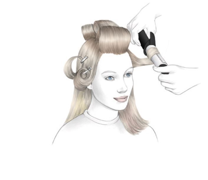 <strong>STEP 7:</strong> Use a large curling iron to create movement. Clip the hair in place.