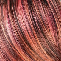 This snapshot of a look by Sydney Lopez captures a dimensional finish that incorporates coral.