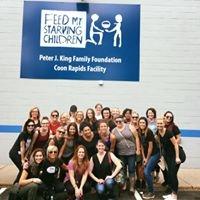 The team from Taj Salon & Spa in Brooklyn Park, MN, gather to help kids.