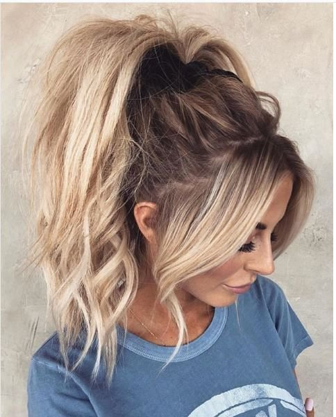 All hail the high pony! This style, with it's curly texture and pulled-out pieces, gives the casual pony a total makeover.