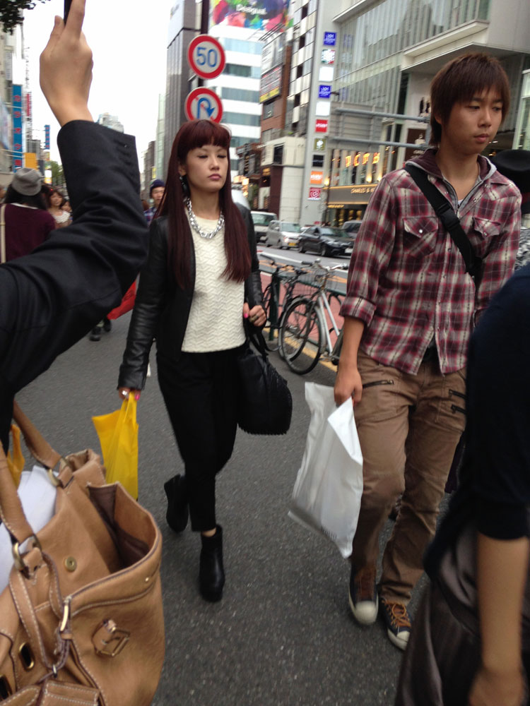 Many young women have a thick, blunt fringe in Tokyo.