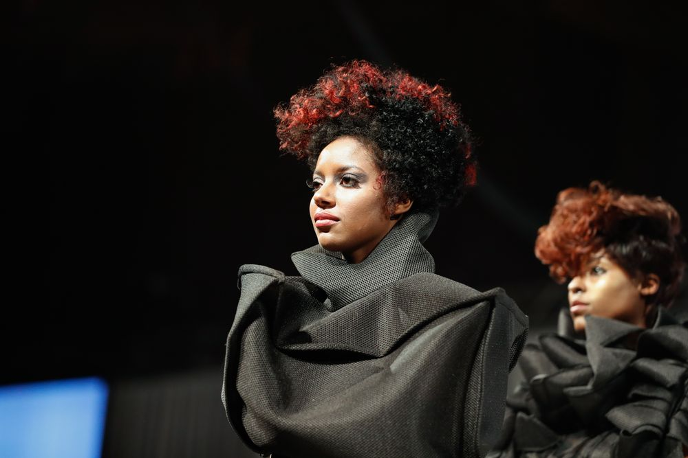 Tippi Shorter and team created strong shapes and high-impact color on textured hair at Aveda Mid-America 2016.