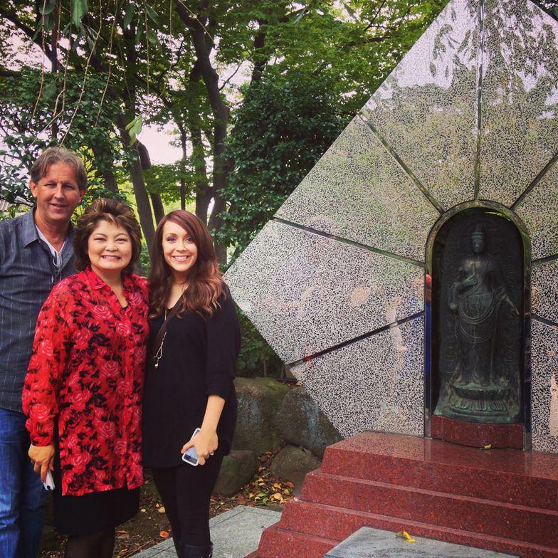 Pivot Point CEO Robert Passage, Jane Yamano of Yamano Beauty College, Alison Shipley of MODERN next to the Scissor God statue.