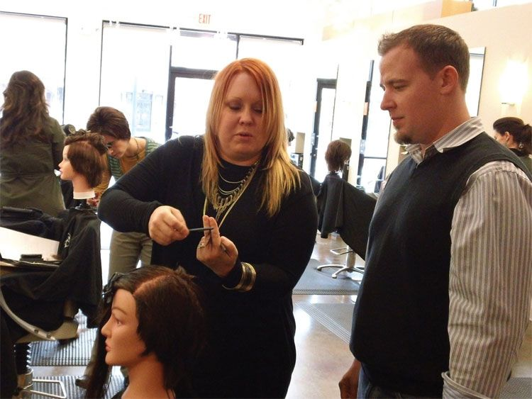Toni&Guys Darian Bishop demonstrates a technique to Blo Stylist Jason Shoop.