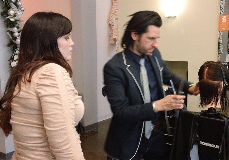 Stylist Brittany Wilson observes as Toni&Guys Aaron Seskin demos a cutting technique.