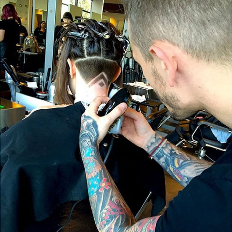 Spanakos pulls the hair up in four sections instead of two, preventing tension that could cause the line from ear to ear to not be straight.