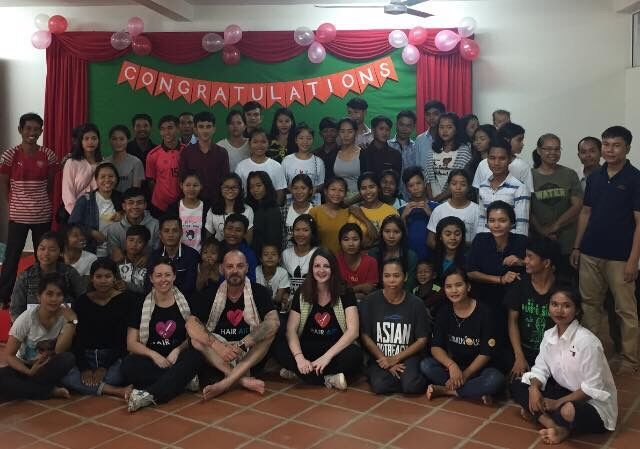 Hair Aid's Camobian graduating class with volunteers.