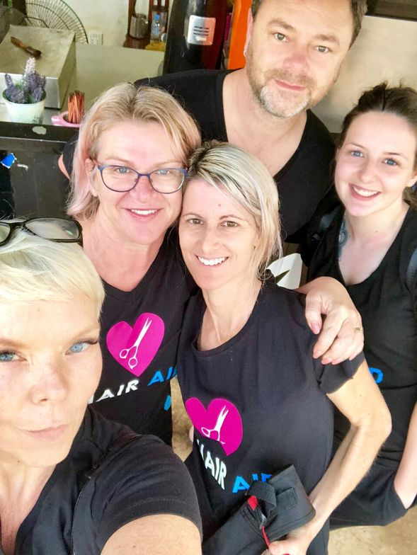Tabatha Coffey (lower left) with Selina Tomasich (in glasses) and other Hair Aid volunteers.