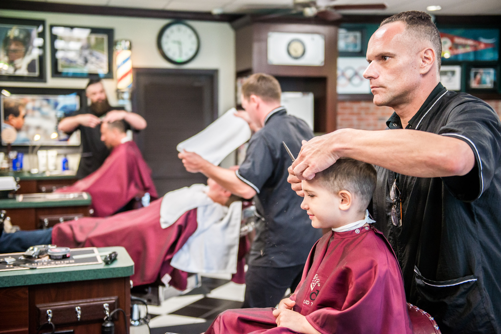 Barbers at work at V's.