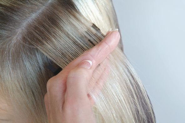 Placement: Take a section of hair ready to weave for highlights. Place the Weaveze under the section.