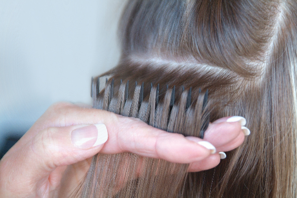 Initial Highlights: Create evenly spaced weaves. Turn the wrist, tilting the Weaveze towards you. Use a pin tail comb to insert in between the layers of the separated hair created by the weaving teeth. The top layer will produce evenly spaced weaves ready for color application.
