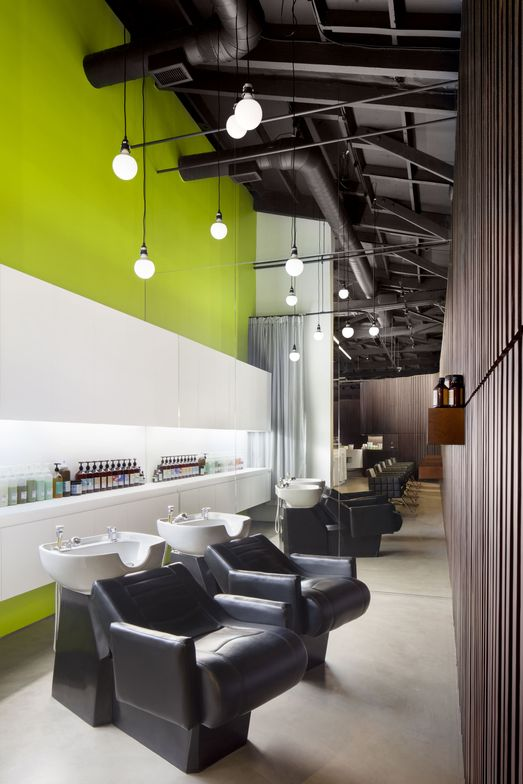 """There was a lot of attention paid towards even, fluid lines between the orientation and design of the walls,"" Weidner says. ""The shampoo area was intentionally sectioned off to give our clients an additional level of intimacy and privacy, and also keeps the energy flowing."""