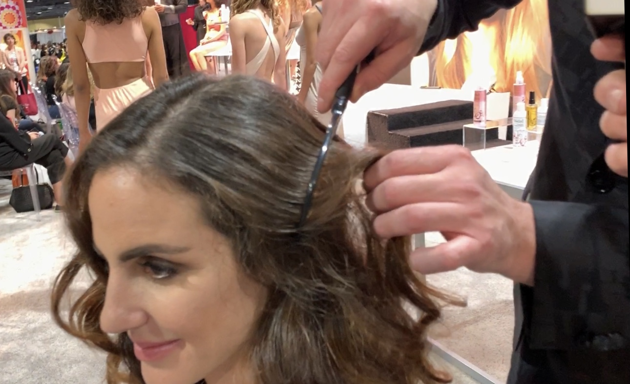 Using a Wet Brush product to build volume and shape in the hair.