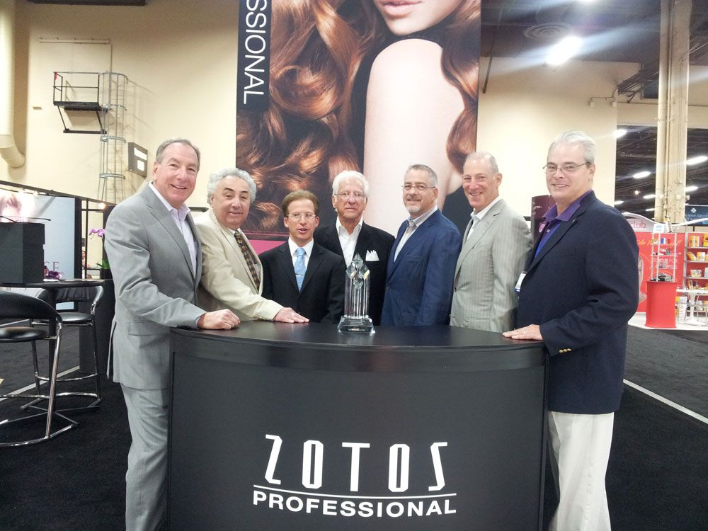 The CFN Sales and Marketing team received the Zotos Professional Rep of the Year Award. From left: Gary Fiskin, Cosmo DeSteno, Brett Cohen, Chuck Cohen, Mark Richman and Steve Nutile of CFN with Zotos' Greg Pataky.