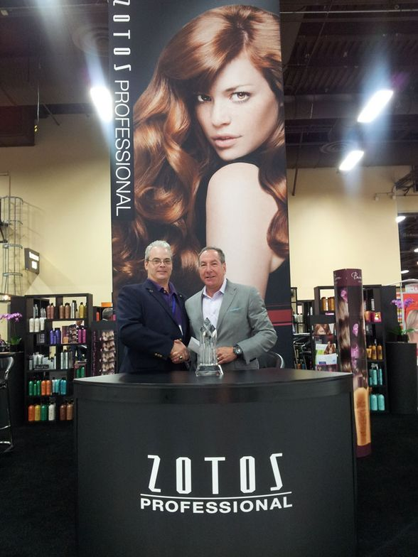 Zotos Professional's Greg Pataky with Gary Fishkin of CFN Sales & Marketing, third place sales winner for Bain de Terre.