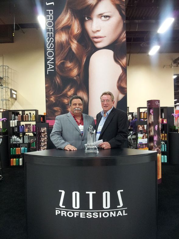 Steve Simon of Van Nest Coleman Southwest, first place sales for Zotos Professional, with Zotos' Jim Henrietta.