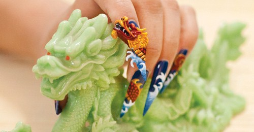The winner of this year's dragon nail art mural contest, nail artist Robert  Nguyen lent his 3-D nail artistry to this month's Lunar New Year-themed ... - Behind The Scenes: Enter The Dragon - - NAILS Magazine