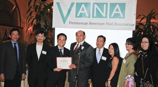 Calif. state senator Lou Correa presents a certificate of recognition to VANA president Mike Vo. From left to right: Howard Ngo, secretary Thong Vu, president Mike Vo, Senator Lou Correa, vice president John Nguyen, Dee Nguyen (board of directors), treasurer Barbara Trinh, and Lisa Huey (board of directors).