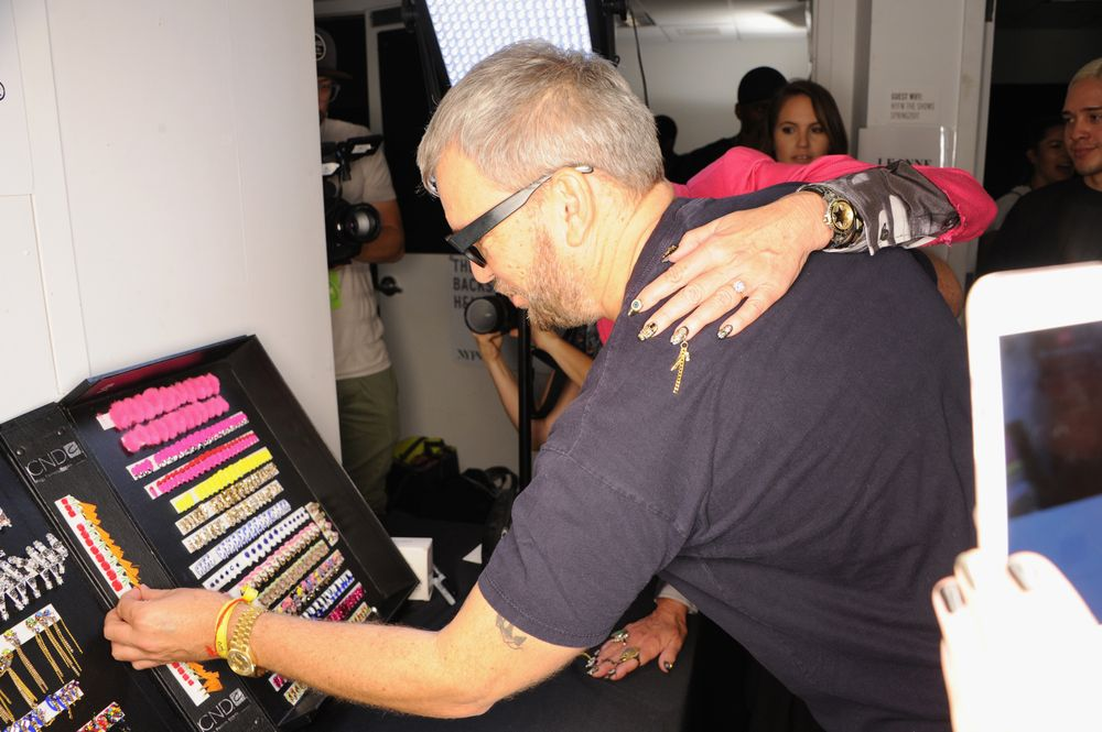 <p>Johnson Hartig of Libertine checking out CND's nail line-up</p>