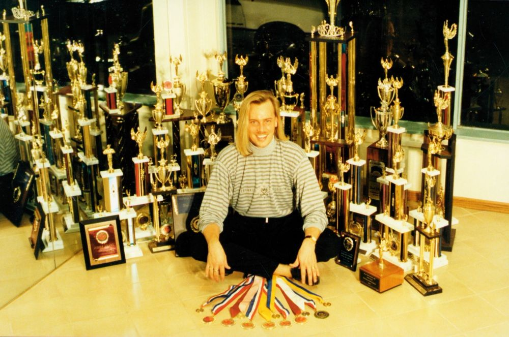<p>An early photo of Tom with his many nail competition awards.</p>