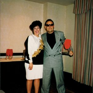 Helen Vanegas shown here in 1993 at NAILS Magazine's 10th Anniversary party with Tony Cuccio of...