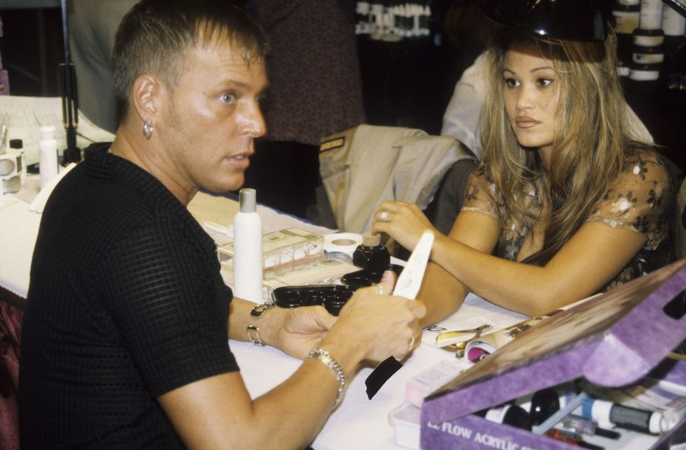 <p>On the competition floor with his then-model Alisha Rimando Botero.</p>
