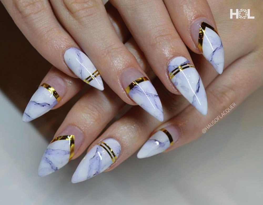<p>Stephanie Urmeneta, a nail artist and technician at Haus of Lacquer, created these marbled and gold-accented nails.</p>