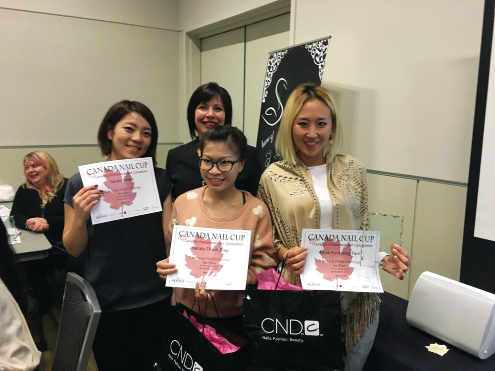 <p>Winners of the Canada Nail Cup's CND 20min Gel Polish Challenge show off their certificates.</p>