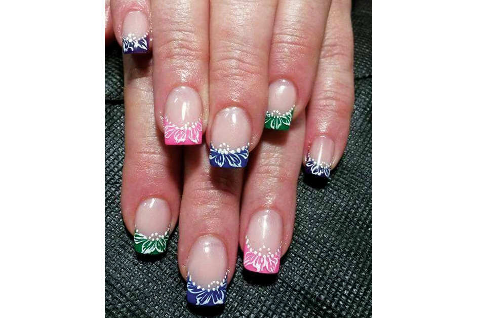 <p>These colorful French nails were created by Elmarie Singleton, who completed a nail art course with E.MI School of Nail Design—Pretoria.</p>