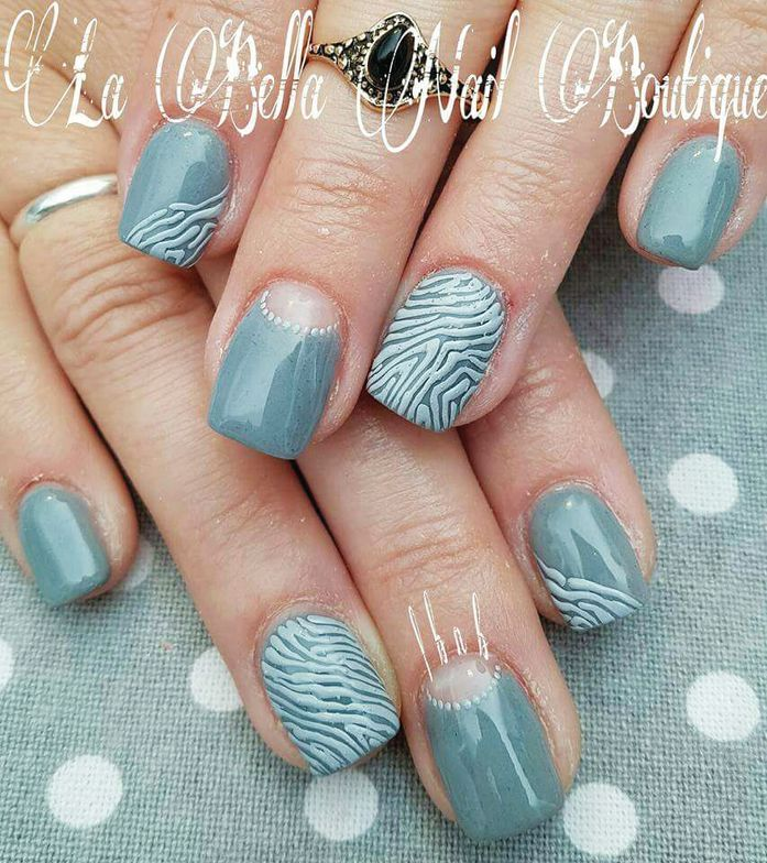 <p>This nail art design on short nails is by Marichelle De Costa, who completed a nail art course with E.MI School of Nail Design—Pretoria.</p>