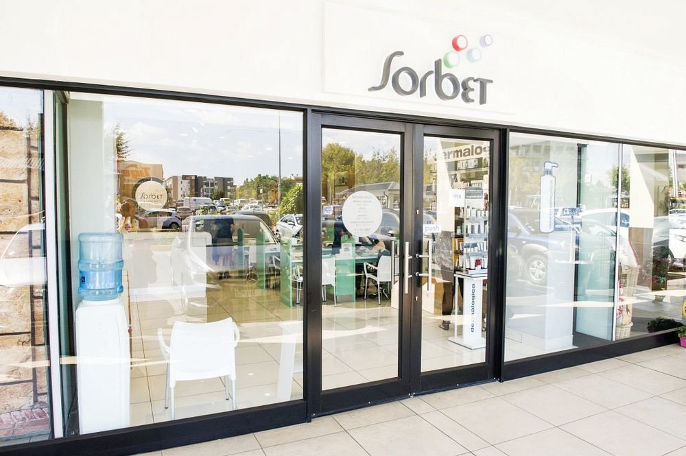 <p> South Africa-based salon chain Sorbet maintains a consistent look with its bubbly logo and signage.</p>