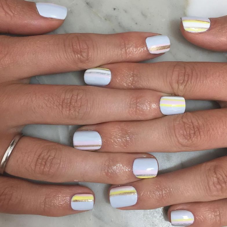 <p>This stripes-on-white nail art design was created by The Nail Lab.</p>