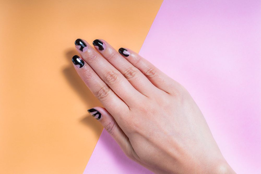 <p>Negative space nail art is a trend cited by several nail professionals in Australia. This design is by Chelsea Bagan of Trophy Wife. Photography by Ryan Wheatley</p>