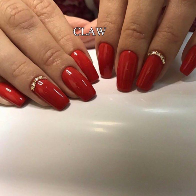 <p>Red is making a comeback as a popular nail color in India, such as the deep color in these nails by Claw.</p>