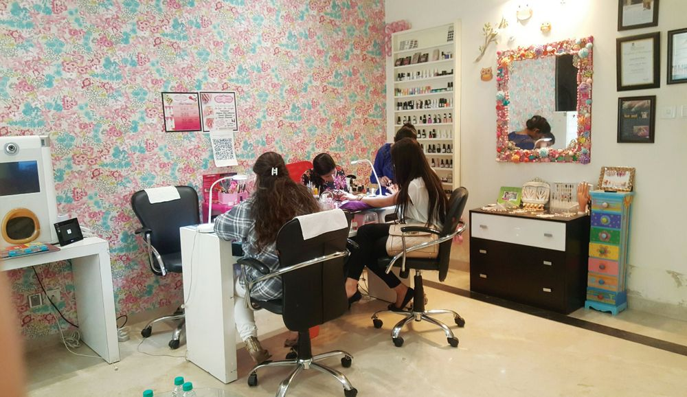 <p>Nail techs work on clients at Nails By Gunjan. Facing a shortage of qualified techs, the owner has started a training academy to help fill the void.</p>
