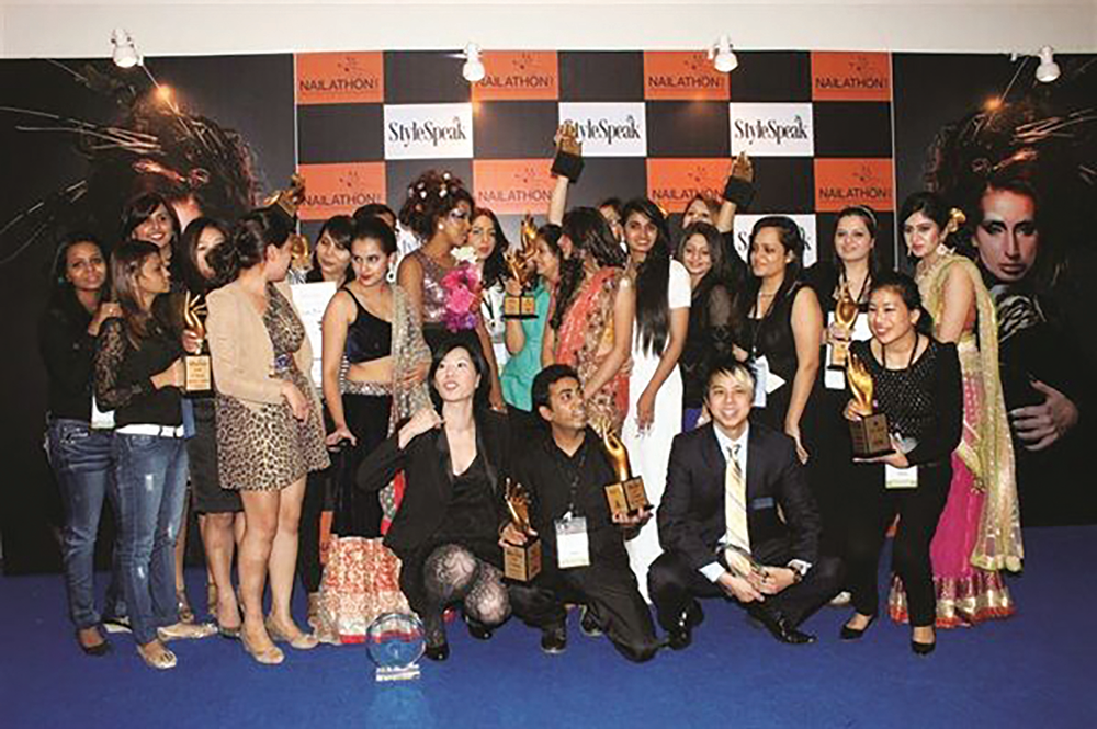 <p>Participants at the first StyleSpeak Nailathon competition in 2014 pose in front of the step-and-repeat.</p>