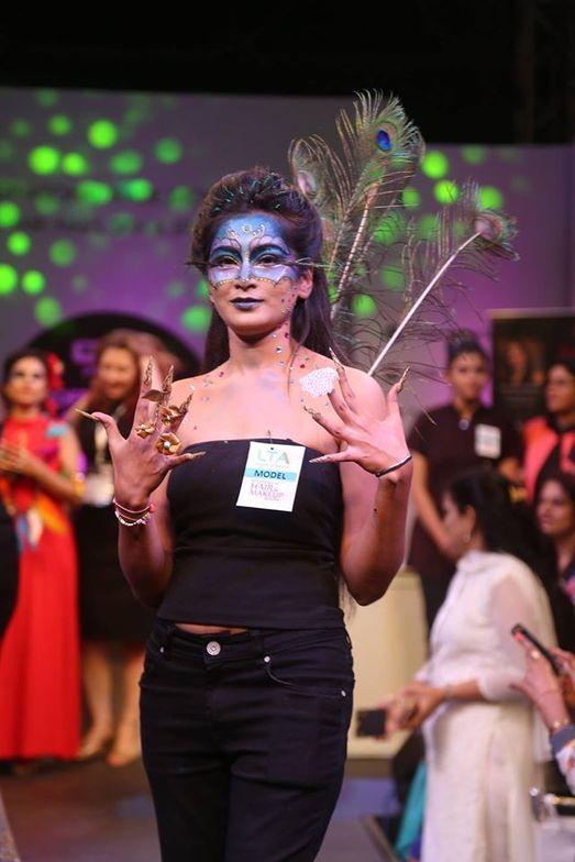 <p>A model walks the runway at a fashion show at Professional Beauty Mumbai.</p>